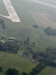 Crash site west of a 3,500-foot runway 26 at Lexington airport. August 27, 2006