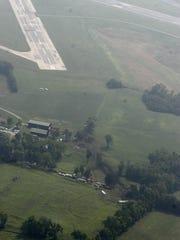 Crash site west of a 3,500-foot runway 26 at Lexington