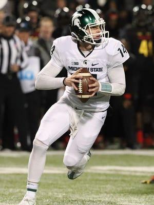 Michigan State quarterback Brian Lewerke looks to pass against Maryland.