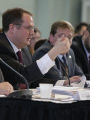 Sen. Joe Hune, R-Gregory in Flint during a hearing