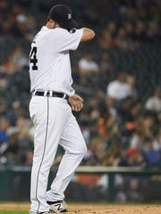 Tigers pitcher Chad Bell reacts after Athletics third