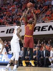 NCAA Basketball: Iowa State at Oklahoma State Iowa State Cyclones forward Solomon Young (33) shoots while defended by Oklahoma State Cowboys forward Yankuba Sima (35) during the first half at Gallagher-Iba Arena last season.