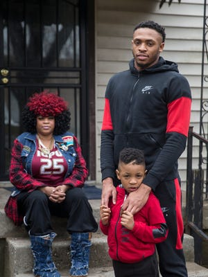 """From left, Terrie Wimberly, her son Ron Patterson and his son BJ, at Ron's mother's home in Indianapolis, Friday, Feb. 23, 2018. Patterson, a Broad Ripple grad, originally intended to play for Indiana University as part of """"The Movement,"""" but instead earned a degree at Brewster Academy prep school and attended Syracuse University for a stint, before personal matters led him home to IUPUI. Patterson will play his senior day game with the Jaguars on Sunday, Feb. 25, 2018."""