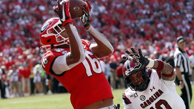 Georgia wide receiver Demetris Robertson (16) of Savannah catches a pass for a touchdown as South Carolina defensive back R.J. Roderick (10) defends on Oct. 12, 2019, in Athens.