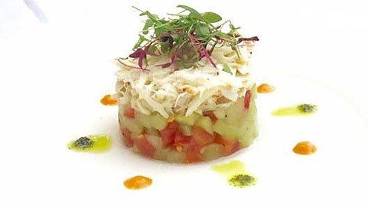 Trevini's classic crabmeat panzanella salad (pictured) has been adjusted for the restaurant's takeout/curbside pickup menu. The new version features, in addition to crabmeat, such ingredients as melon.