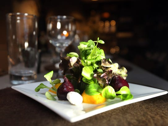 Micro green beet salad is a dish served at Le Moulin
