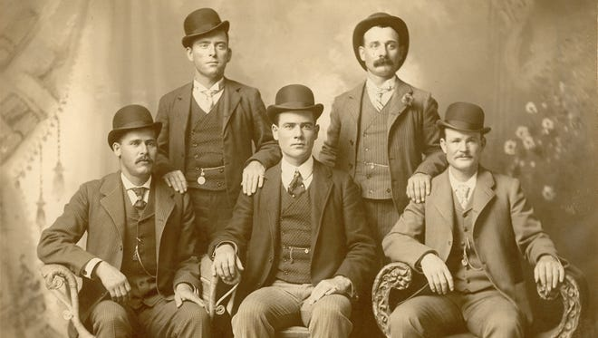 In a photograph taken just over a year before his Knoxville arrest, Harvey Logan, standing at right, poses with other members of the Wild Bunch in Fort Worth, Tex. Seated are Harry A. Longabaugh (the Sundance Kid), left, Ben Kilpatrick and Robert Leroy Parker (Butch Cassidy). Standing are Will Carver and Logan