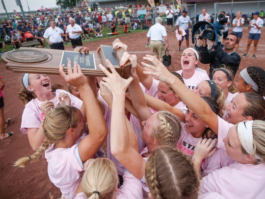 Members of the Pleasant Valley softball team celebrate