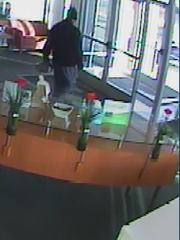 A lone gunman escapes from a Canton bank with an undisclosed amount of cash.