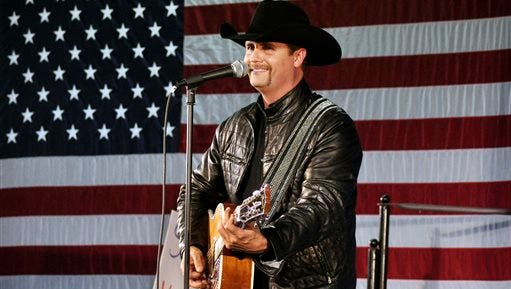 In this Nov. 2, 2009, file photo, John Rich of the musical group Big & Rich performs at a rally for 23rd Congressional District candidate Doug Hoffman in Watertown, N.Y. Mainstream country music has been quietly distancing itself from the Confederate flag for years, but as the debate reignites after a massacre at a black church in South Carolina on June 17, country artists still struggle to articulate their feelings about the flag's history and symbolism. Rich told Fox News' Sean Hannity that he agreed with South Carolina Gov. Nikki Haley's call to remove the Confederate flag from the state Capitol.