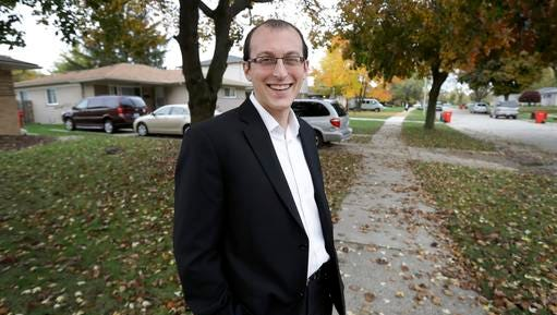 In this photo taken Nov. 3, 2016, Moshe Sherizen, an undecided voter, is shown outside his home in Southfield, Mich. After all the sound, fury, fact, fallacy, bluster and blarney of the 2016 presidential campaign, there still are undecided voters out there. Really. And they're not just people who've buried their heads in the sand. Some thoughtful people just do not know what to do with the choices they've been given, yet are determined to exercise their right to vote.
