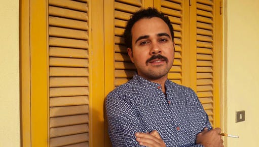 FILE - In this undated file image Egyptian author Ahmed Naji poses for a photo in Cairo, Egypt. Naji on Thursday, Dec. 22, 2016, has walked out of a Cairo police station, after a court suspended his two-year-sentence pending review of his appeal on obscenity charges.