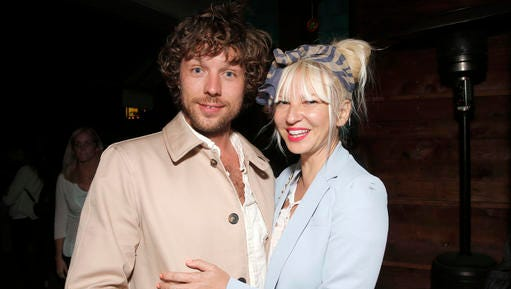 """FILE - In this Aug. 7, 2014 file photo, filmmaker Erik Anders Lang, left, and singer Sia attend a party after the premiere of """"The One I Love,"""" in Los Angeles. Court records in Los Angeles show Sia filed for divorce from her husband of two years, Lang, on Dec. 20, 2016, citing irreconcilable differences."""