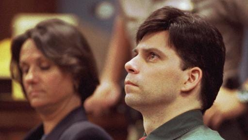 FILE - In this Oct. 20, 1995, file photo, Lyle Menendez looks up during testimony in his and brother Erik's retrial for the shotgun slayings of their parents in Los Angeles. With Lyle is his attorney Terri Towery. Menendez told ABC News in a phone interview from a California prison released Jan. 5, 2017, that he maintains a close bond with his brother, even though he is being housed at a separate facility.