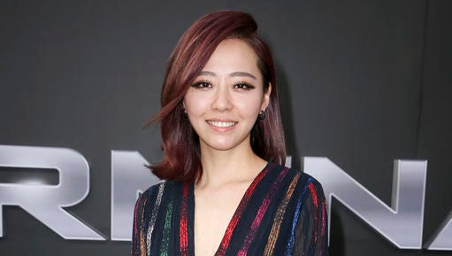 """FILE - This June 28, 2015 file photo shows Chinese pop singer Jane Zhang at the premiere of """"Terminator Genisys"""" in Los Angeles. Zhang teamed up with Grammy-winning hitmaker Timbaland for the pop song """"Dust My Shoulders Off,"""" which reached the top 10 on the U.S. iTunes' songs chart. She plans to release an album this year."""