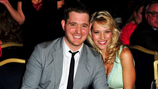 "FILE - In this June 29, 2012, file photo, singer Michael Buble and his wife, Argentine TV actress Luisana Lopilato, pose at the Nordoff Robbins 02 Silver Clef Awards at London Hilton, in London. Lopilato says her and Buble's son Noah is doing ""well"" following successful cancer treatment."