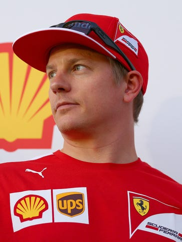 Kimi Raikkonen of Finland and Ferrari looks on as he