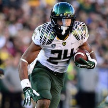 Thomas Tyner is part of a three-headed Oregon running back corps that conceivably could accumulate 3,000 yards this season.