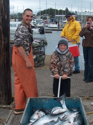 A most memorable opener. Spencer Lillingston, then-10, can't budge this wagonload of salmon on the coho opener in 2009 when all 17 anglers aboard the Umatilla II out of South Beach Marina, Store & Charters limited. Zach Harper, left, the first mate and son of skipper Darrell Harper, got the fish rolling.