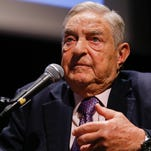 Soros Fund Management President Georges Soros speaks during a conference at the Bozar Palace in Brussels in 2013