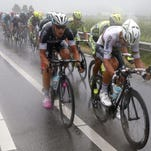 Etixx Quick Step team rider Michal Kwiatkowski (R) of Poland is seen during the second stage of the 102nd edition of the Tour de France 2015 cycling race.