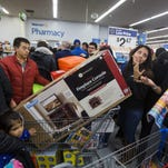 Bargain hunters crowd a Walmart store in Fairfax, Virginia, to take advantage of Black Friday sales a day early on Thanksgiving Day 2014.