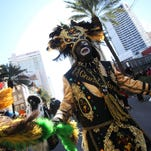 The Gulf Coast Carnival Association Mardi Gras Parade rolls up Lemeuse Street in Biloxi, Miss. on Tuesday.