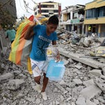 Ecuadorians recover belongings from their homes in Pedernales, Ecuador. The death toll from the country's earthquake was set to rise sharply after authorities warned that 1,700 people were still missing. A 6.1-magnitude earthquake struck off the coast of Ecuador Wednesday, just four days after a more powerful quake killed more than 500 people.