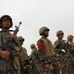 Afghan soldiers attend a graduation ceremony of Afghan National Army soldiers in Shorabak district of Helmand province, Afghanistan.