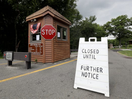 A sign sits at the entrance of Cheesequake State Park,