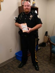 Here Asst Chief Chad Vos receives the doses for Morganfield PD.