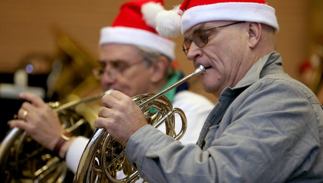 Members of the San Angelo Community Band play a concert for residents during the Christmas tree lighting ceremony on Saturday evening.