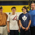 Moeller has picked up their summer hockey workouts in preparation for their season in the Capital Hockey Conference based in Columbus. Helping out is veteran assistant Pat Orloff. To Orloff's right are seniors Michael Rawlings, Braeden Bowra and trainer Matt Wilson.