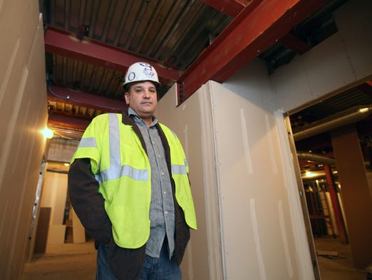 Mike Aponte, the president of Tyrek Heights Erectors in Yonkers, stands near some steel work that his company installed, in the new New York State Police barracks under construction in West Nyack, March 25, 2014. His company is a minority owned business involved in the Tappan Zee Bridge replacement project.