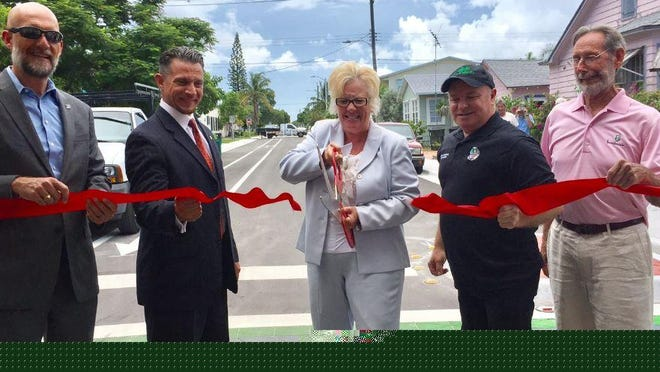 City Manger Michael Bornstein (far right) with Palm Beach County's Department of Economic Sustainability's Director of Operations & External Affairs' Carlos Serrano; Mayor Pam Triolo; Vice Mayor Andy Amoroso and Commissioner Herman Robinson in 2018.
