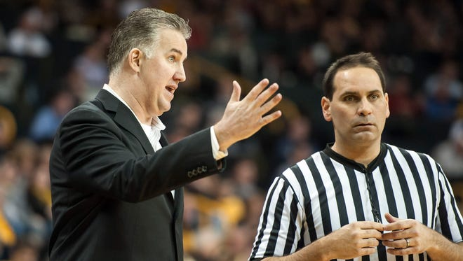 Purdue Boilermakers head coach Matt Painter talks with a referee during the first half against the Iowa Hawkeyes at Carver-Hawkeye Arena.