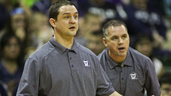 FILE -- Chris Holtmann (right) has now stepped in for Brandon Miller (left) to guide Butler in the interim.