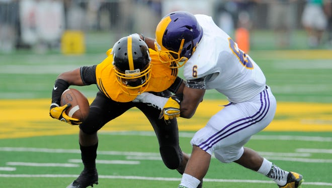 Detroit King's Dontre Boyd, who signed with Western Michigan, is pictured in action against Warren De La Salle during last year's Prep Kickoff Classic at Wayne State.