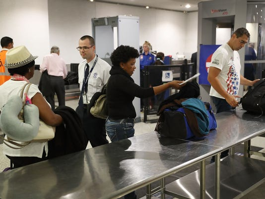 Transportation Security Administration Officials Demonstrates Time Saving Travel Tips At Miami Airport