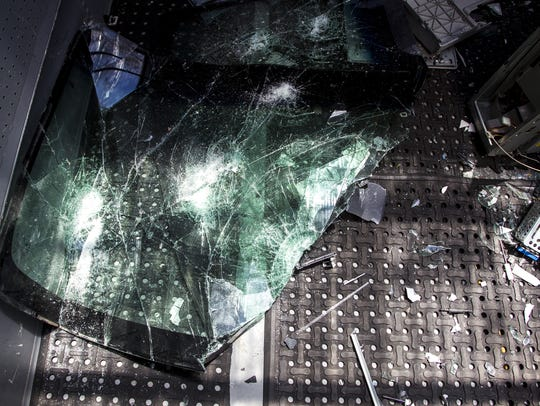 Smashed objects are shown on the Insanity AZ bus on