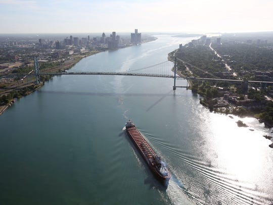 A freighter is upbound on the Detroit River between