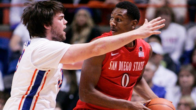 San Diego State Aztecs forward Skylar Spencer is guarded by Boise State Broncos forward Nick Duncan during first half action at Taco Bell Arena.