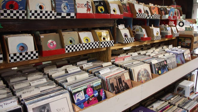 Rows and rows of vinyl records fill the Little Big Store in Raymond. Most albums cost between $8 and $12 and singles are usually $2 to $5.