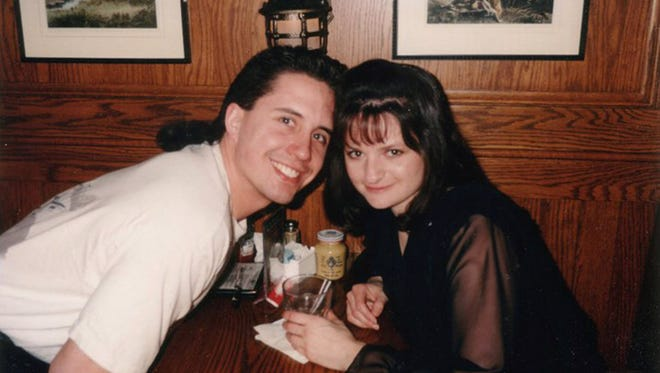 Mike and Kris Gutierrez in 1995 on the first anniversary of their first date. Mike and Kris met in 1994 and went on their first official date to John Hawks Pub on March 25 of that year. The Menomonee Falls couple returned to the downtown restaurant every March 25 since then, always sitting in the same booth and posing for a photo. John Hawks closed recently, and the couple hopes to obtain the booth and put it in their basement.