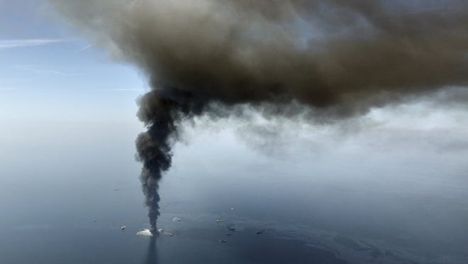 The Deepwater Horizon oil rig burns April 21, 2010. A last-ditch safety device that didn't stop the BP oil spill had multiple failures, wasn't tested properly and still poses a risk for many rigs, a federal investigation board concluded.