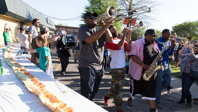 The Soul Express Brass Band make their way through the first annual Acadiana Po' Boy Festival in downtown Lafayette April 2, 2016