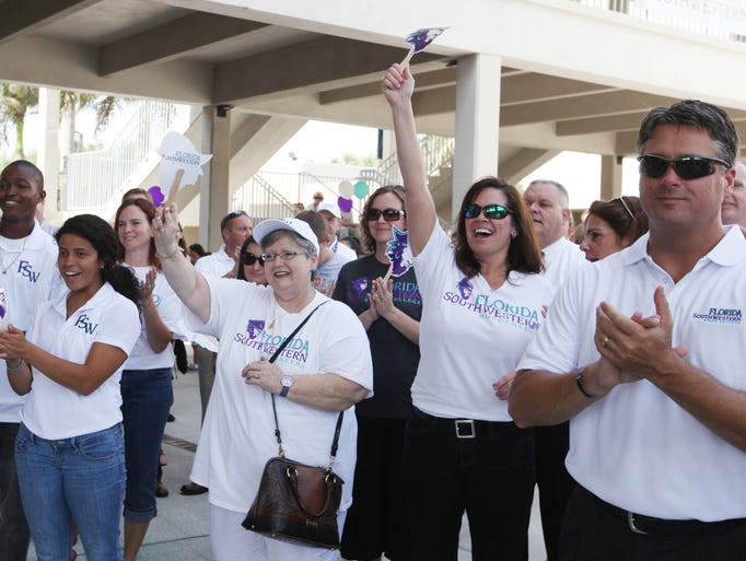 Danessa Stevens, Project Coordinator for FSW, second from right, celebrates along with other students, faculty, and visitors to the campus during a ceremonial unveiling of Edison State College's new name. Edison State College is now officially Florida SouthWestern State College.
