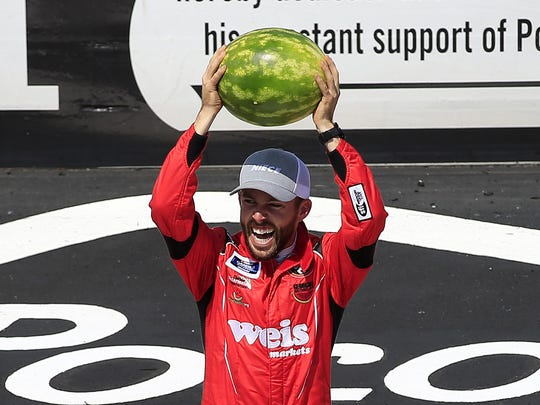 LONG POND, PENNSYLVANIA - JULY 27: Ross Chastain, driver of the #45 Niece/Acurlite Chevrolet, celebrates by smashing a watermelon following his victory in the NASCAR Gander Outdoors Truck Series Gander RV 150 at Pocono Raceway on July 27, 2019 in Long Pond, Pennsylvania. (Photo by Chris Trotman/Getty Images) ORG XMIT: 775380092 ORIG FILE ID: 1164582366