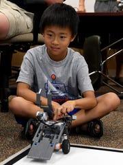 Hibiki Kaneko prepares to start his robot for battle