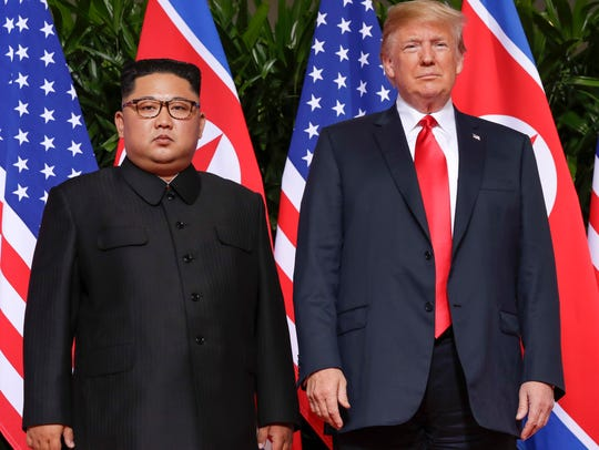 President Donald Trump stands with North Korea leader